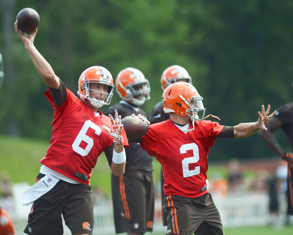 Description of . Duncan Scott/DScott@News-Herald.com Quarterbacks Brian Hoyer, left, and Johnny Manziel drill side-by-side as the Cleveland Browns opened training camp on July 26 with their first practice at Browns headquarters in Berea.
