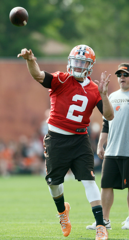 Description of . Duncan Scott/DScott@News-Herald.com Johnny Manziel throws a pass as the Cleveland Browns opened training camp on July 26 with their first practice at their headquarters in Berea.