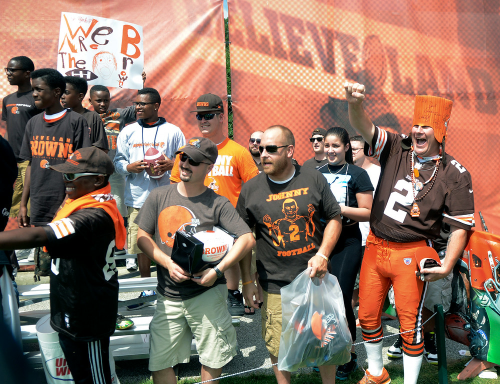 Description of . Duncan Scott/DScott@News-Herald.com Fans cheer on their team as the Cleveland Browns opened training camp on July 26 with their first practice at Browns headquarters in Berea.