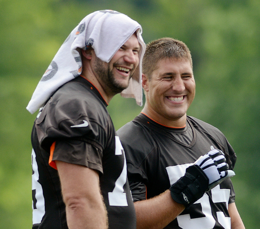 Description of . Duncan Scott/DScott@News-Herald.com Joe Thomas, left, and Alex Mack laugh during a break as the Cleveland Browns opened training camp on July 26 with their first practice at Browns headquarters in Berea.