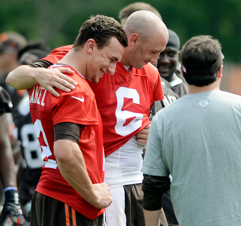 Description of . Duncan Scott/DScott@News-Herald.com Brian Hoyer puts his arm around Johnny Manziel at the end of practice as the Cleveland Browns opened training camp on July 26 at Browns headquarters in Berea.