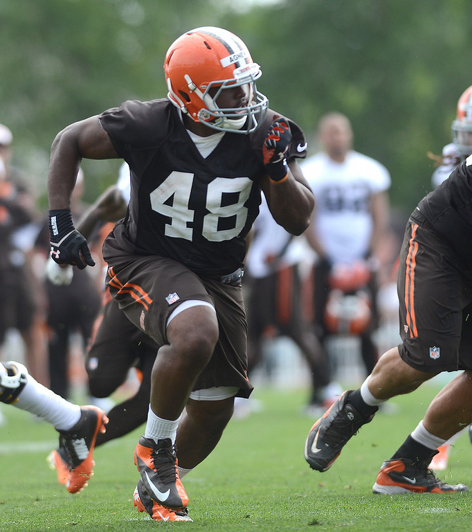 Description of . Duncan Scott/DScott@News-Herald.com Ray Agnew pulls out to block as the Cleveland Browns opened training camp on July 26 with their first practice at their headquarters in Berea.