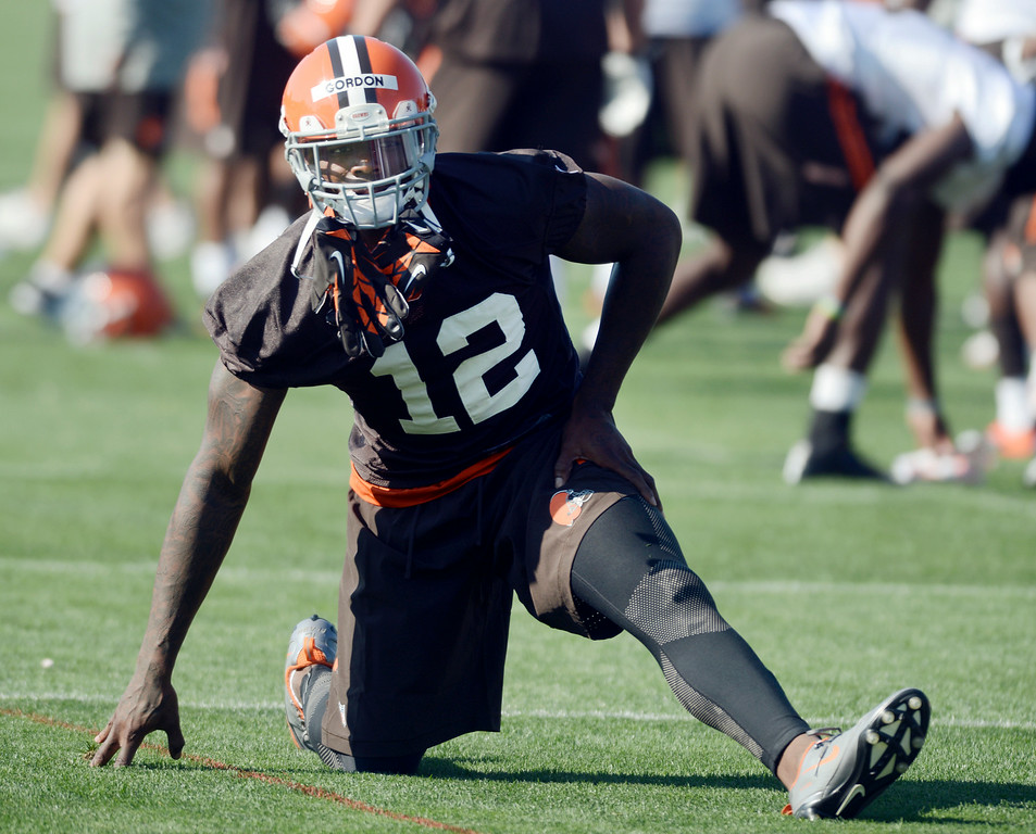 Description of . Duncan Scott/DScott@News-Herald.com Josh Gordon stretches as the Cleveland Browns opened training camp on July 26 with their first practice at Browns headquarters in Berea.