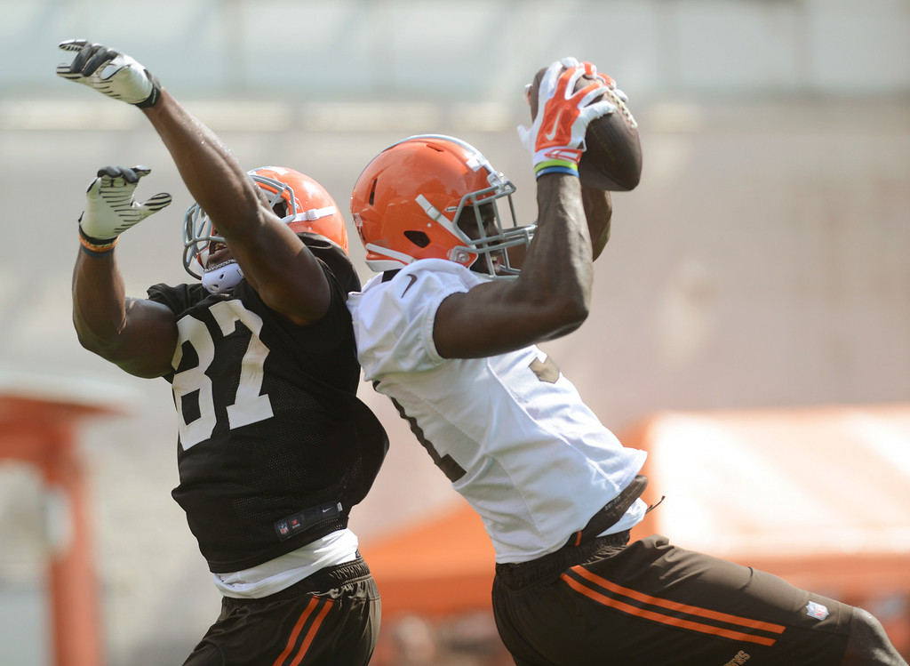 Description of . Duncan Scott/DScott@News-Herald.com Barkevious MIngo makes an interception on a pass intended for tight end Emanuel Ogbuehi as the Cleveland Browns opened training camp on July 26 with their first practice at Browns headquarters in Berea.