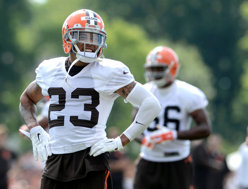 Description of . Duncan Scott/DScott@News-Herald.com Joe Haden acknowledges the fans cheers as the Cleveland Browns opened training camp on July 26 with their first practice at Browns headquarters in Berea.