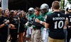 Jeff Forman/JForman@News-Herald.com Lake Catholic students wear shirts in remembrance of MIke Robinson as they cheer the Cougars before they take the field against Ursuline Saturday.
