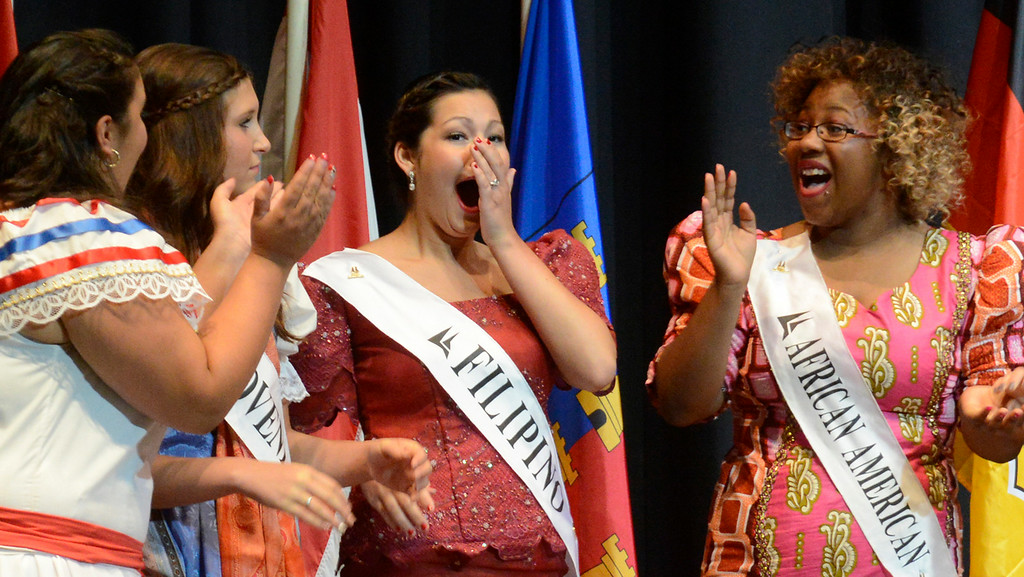 Description of . Maribeth Joeright/MJoeright@News-Herald.com <p> Colleen Ziegman, Filipino Princess, center, reacts as she is announced the winner of the 48th annual Lorain International Princess Pageant, June 26, 2014.