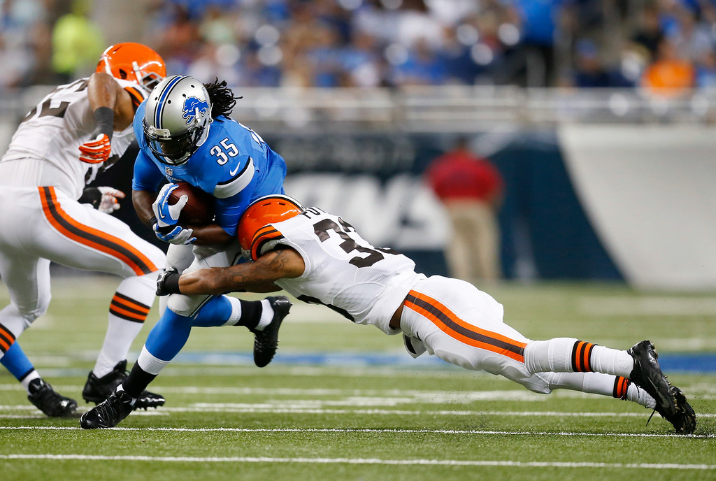 Description of . Detroit Lions running back Joique Bell (35) breaks the tackle of Cleveland Browns cornerback Jordan Poyer (33) in the first half of a preseason NFL football game at Ford Field in Detroit, Saturday, Aug. 9, 2014. (AP Photo/Rick Osentoski)