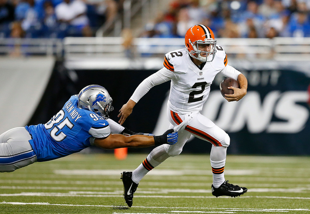 Description of . Cleveland Browns quarterback Johnny Manziel (2) breaks the tackle of Detroit Lions outside linebacker Kyle Van Noy (95) in the first half of a preseason NFL football game at Ford Field in Detroit, Saturday, Aug. 9, 2014.  (AP Photo/Rick Osentoski)