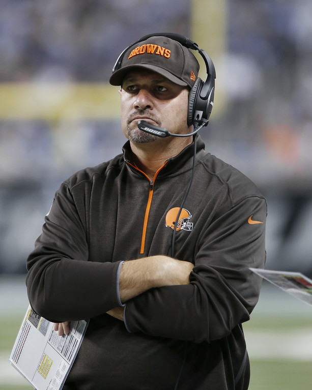 Description of . Cleveland Browns head coach Mike Pettine watches against the Detroit Lions in the first half of a preseason NFL football game at Ford Field in Detroit, Saturday, Aug. 9, 2014. (AP Photo/Duane Burleson)