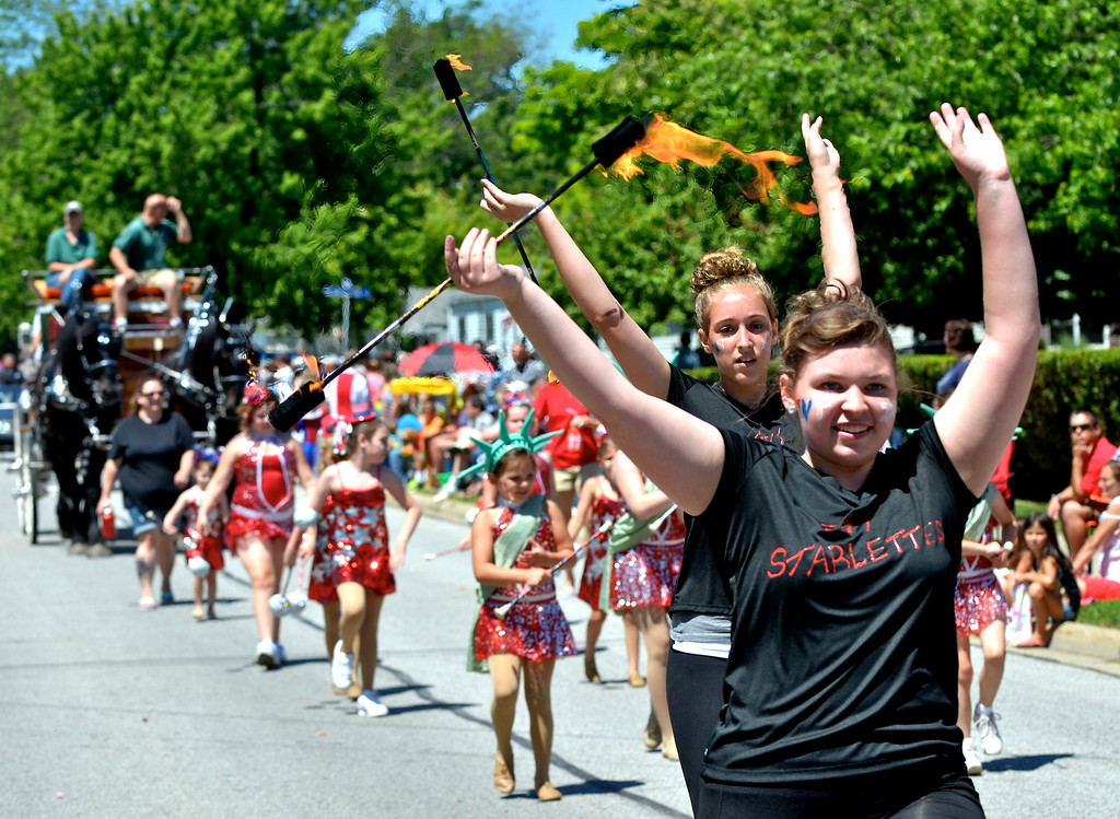 Description of . Jeff Forman/JForman@News-Herald.com The TNT Starlettes march in the Mentor Headlands July 4th Parade.
