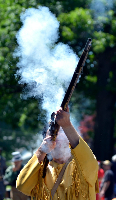 Description of . Jeff Forman/JForman@News-Herald.com Ramrod Buster Justin Hanson fires his musket as he marches in the Mentor Headlands July 4th Parade.