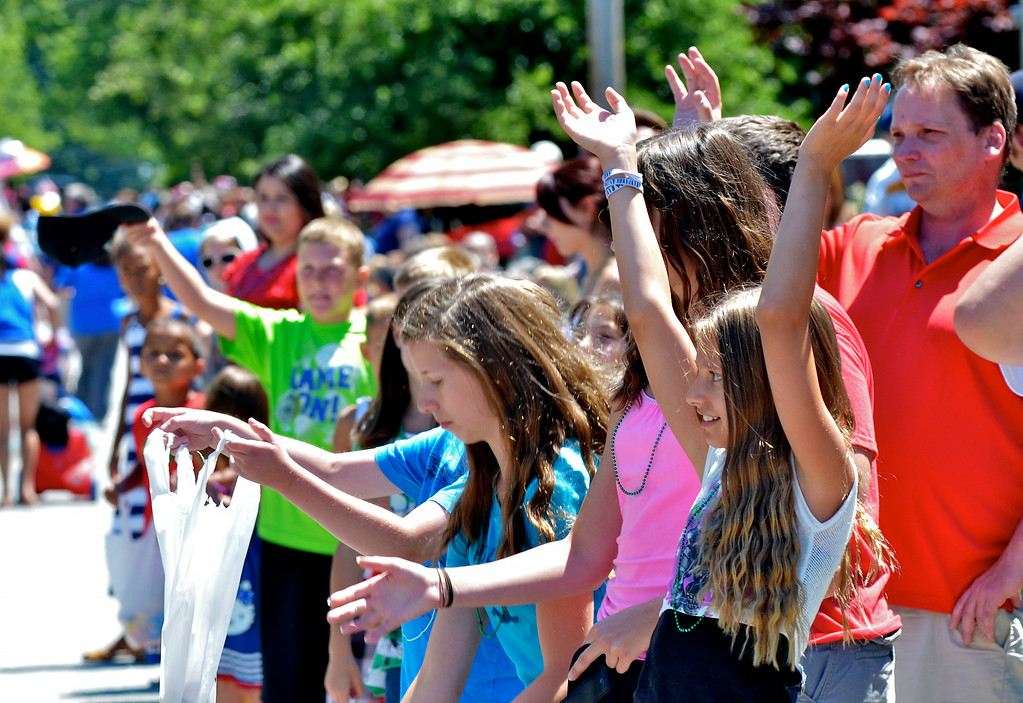 Description of . Jeff Forman/JForman@News-Herald.com Children and adults line the streets for the Mentor Headlands July 4th Parade.