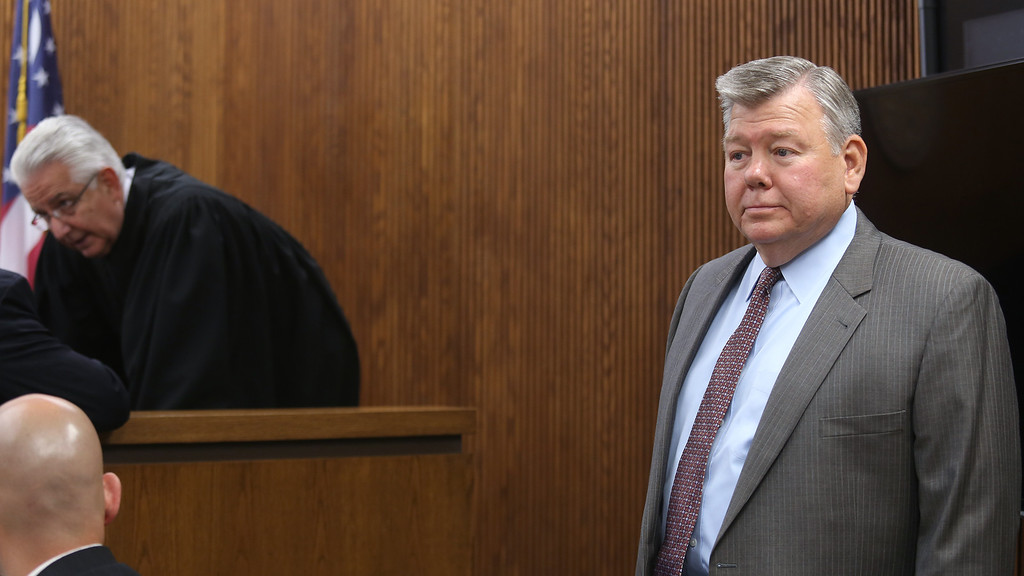 Description of . Michael Allen Blair/MBlair@News-Herald.com Tom Walsh, chief investigator for the Lake County Prosecutors Office steps down from the witness stand as lawyers approach the bench to consult with Judge Joe Gibson during day four of Kevin Knoefel's murder conspiracy trial in Lake County Common Pleas Court on  June 5, 2014.