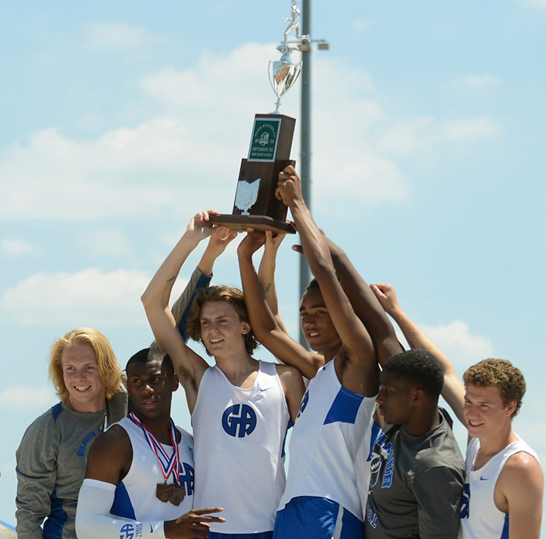 Description of . Maribeth Joeright/MJoeright@News-Herald.com <p> The Gilmour boys track team show off their trophy after winning the runner-up team title in Division III during the state final track and field championships in Columbus, June 7, 2014.