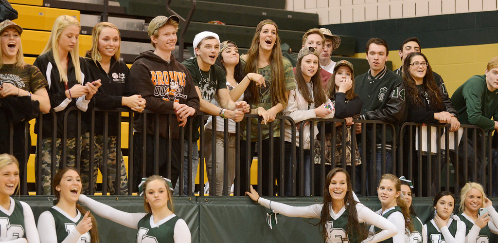 Description of . Maribeth Joeright/MJoeright@News-Herald.com Lake Catholic students watch and celebrate as the boys basketball team receives the Division II district championship trophy after defeating Chagrin Falls by a score of 68-59, March 8, 2014.