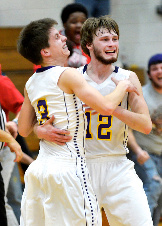 Description of . Jeff Forman/JForman@News-Herald.com Berkshire basketball player Luke Freiling, left, celebrates his fourth-quarter dream shot against Newbury Friday with teammate Josh Garrett.