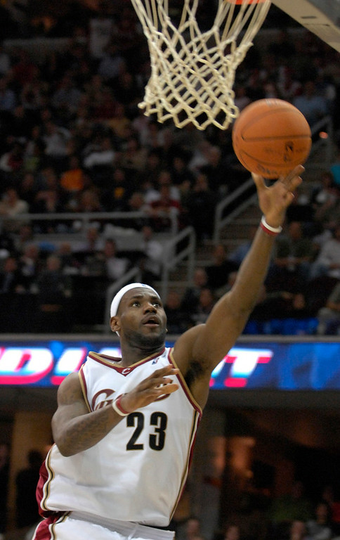 Description of . Lebron James goes up for a shot in the second period of Wednesday season opener against the Wizards.