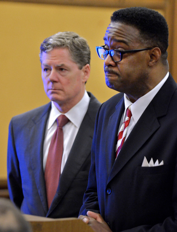 Description of . Jeff Forman/JForman@News-Herald.comFormer Richmond Heights superintendent Robert J. Moore, right, grimaces as he is sentenced to one year in prison by Cuyahoga Common Pleas Judge Shirley Strickland Saffold May 22 for bribery and theft in office. His lawyer John McCaffrey is standing next to him.