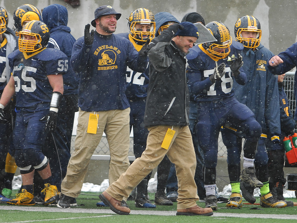 Description of . Michael Allen Blair/ MBlair@News-Herald.com Kirtland head coach Tiger Laverde celebrates Kirtlsand's fourth touchdown during the second quarter of Friday's Div VI state championship victory over Wayne Trace at Fawcett Stadium in Canton.