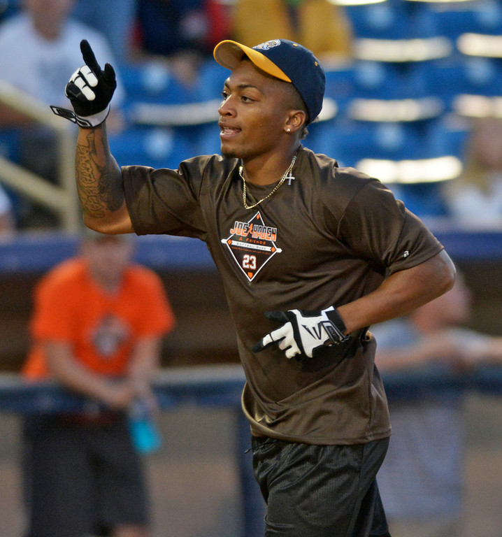 Description of . Jeff Forman/JForman@News-Herald.com Buster Skrine celebrates his home run during the Joe Haden and Friends Softball Game July 17 at Classic Park.