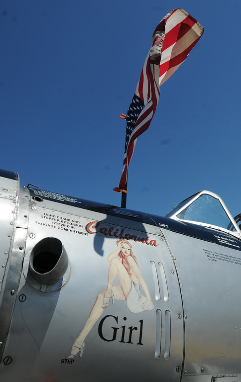 Description of . Jim Bobel/JBobel@MorningJournal.com California Girl nose art on the Navy trainer SVN-1 at the Discover Aviation Air Show at the Lorain County Regional Airport.