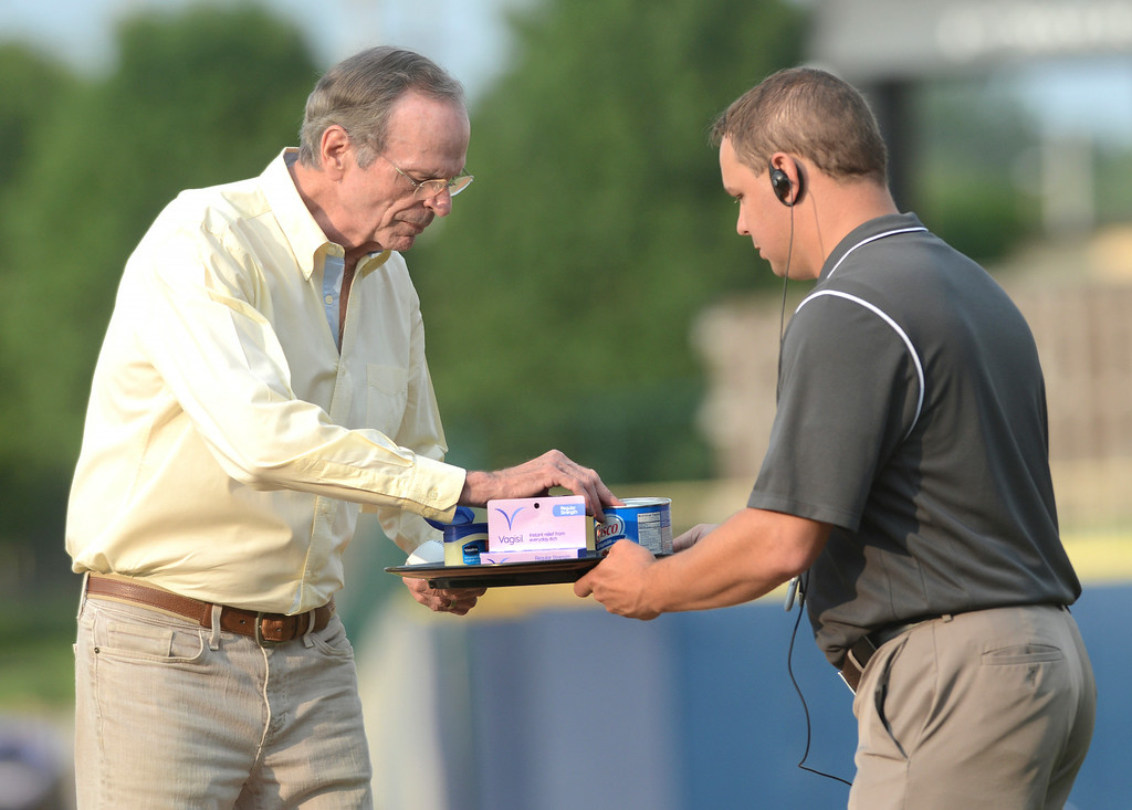Description of . Duncan Scott/DScott@News-Herald.com Chelcie Ross, who played junkball pitcher Eddie Harris in the movie Major League, selects which ointment to doctor the baseball with before throwing out the first pitch at the Lake County Captains game at Classic Park in Eastlake.