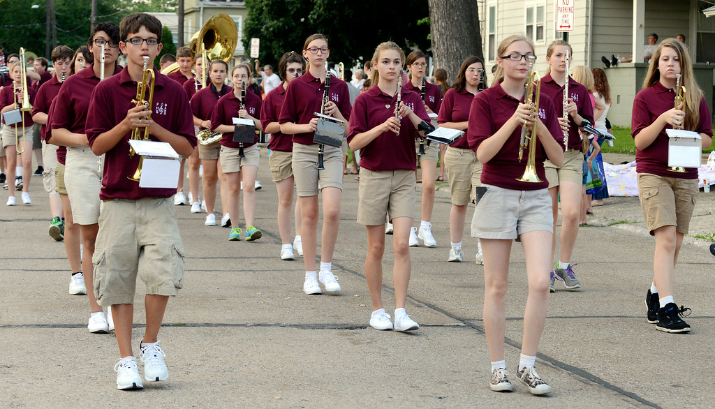 Description of . Maribeth Joeright/MJoeright@News-Herald.com<p> Members of the Fairport Harding High School marching band take part in the Mardi Gras parade, July, 2, 2014.