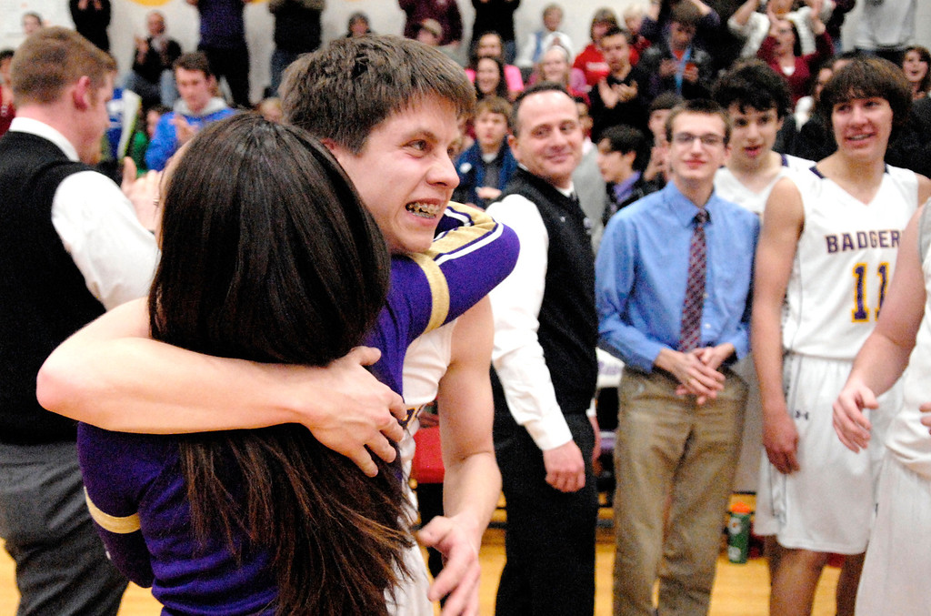Description of . Jeff Forman/JForman@News-Herald.com A cheerleader hugs Luke after  he sunk a shot in the fourth quarter.