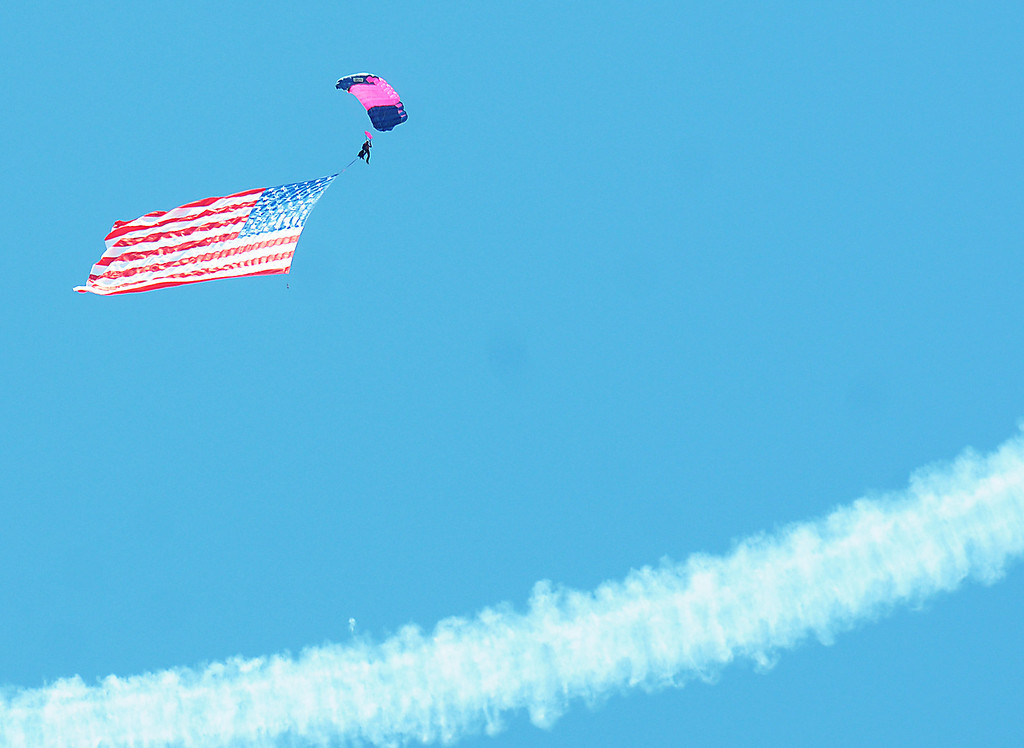 Description of . Jim Bobel/JBobel@MorningJournal.com The Discover Aviation Air Show at the Lorain County Regional Airport opened with a sky diving team bringing the flag in from the sky.