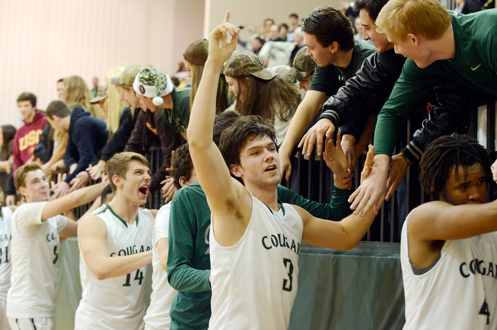 Description of . Maribeth Joeright/MJoeright@News-Herald.com<p> Lake Catholic senior Brett Nalepa and his teammates are congratulated by their classmates after defeating Chagrin Falls 68-59, winning the Division II district championship, March 8, 2014.