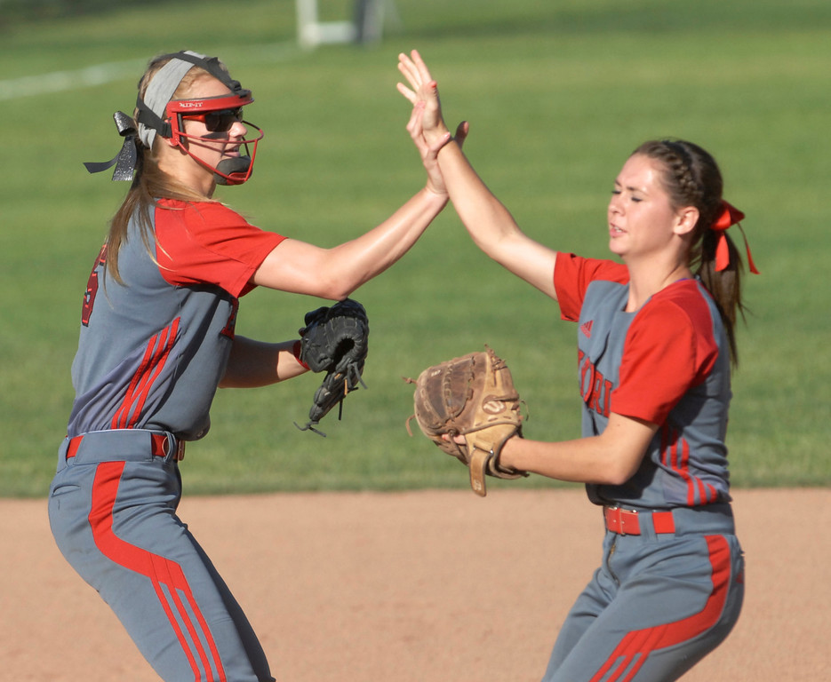 Description of . Jeff Forman/JForman@News-Herald.com Elyria short stop and second baseman Carly Bachna and Mackenzie Phares celebrate a double play during the Pioneer's 9-1 state semi final loss June 5 at Firestone Stadium in Akron.
