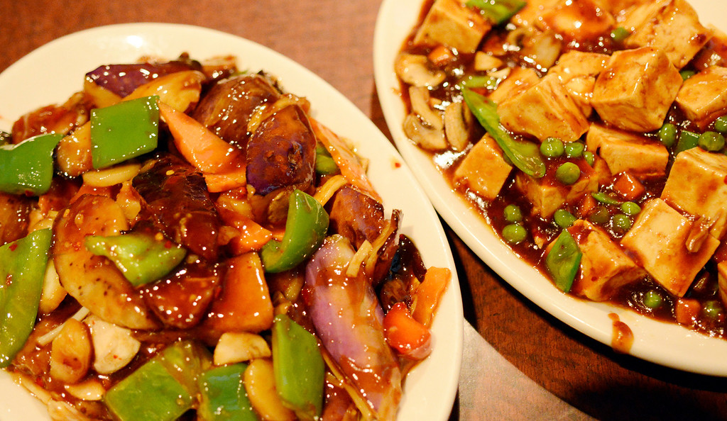 Description of . Maribeth Joeright/MJoeright@News-Herald.com Szechwan Asian eggplant, left, and Mabw tofu are tradtional dishes served during the Chinese New Year.