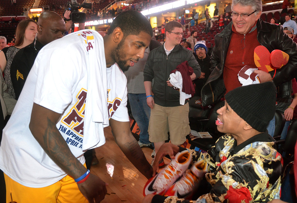 Description of . Michael Allen Blair/Digital First Media Cavs' guard Kyrie Irving gives a pair of basketball shoes to a wheelchair bound Cavs' fan during Fan Appreciation Night April 16 at Quicken Loans Arena. The Cavs defeated the Nets 114-85. Big questions remain with Irving heading into the final year of his contract next season.