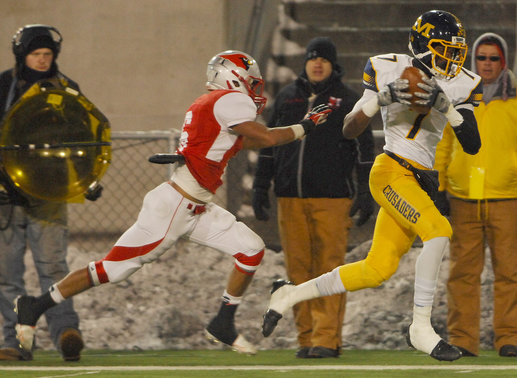 Description of . Michael Allen Blair/ MBlair@News-Herald.com Cincinnati Moeller wide receiver Isaiah Gentry hauls in a long pass behind the defense by Mentor's Kiyah Powell setting up what turned out to be the winning touchdown during Saturday's Div. I state championship game at Fawcett Stadium in Canton.