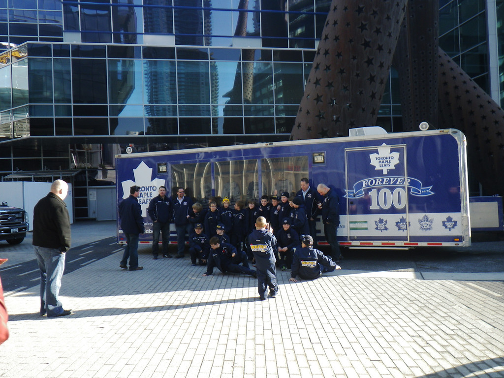 Description of . Janet Podolak/JPodolak@News-Herald.comA kids hockey team on a field trip from the suburbs, poses for photos in front of the bus which earlier that day brought the Maple Leafs home to Toronto from a game in Buffalo.