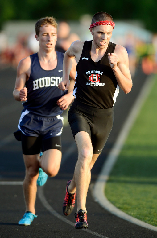 Description of . Maribeth Joeright/MJoeright@News-Herald.com<p> Chardon's Nick Elswick maintains his lead over Hudson's Kyle Mau and was the winner boys 3200 meter run with a time of 8:57:93 and Division I regional record, May 30, 2014.