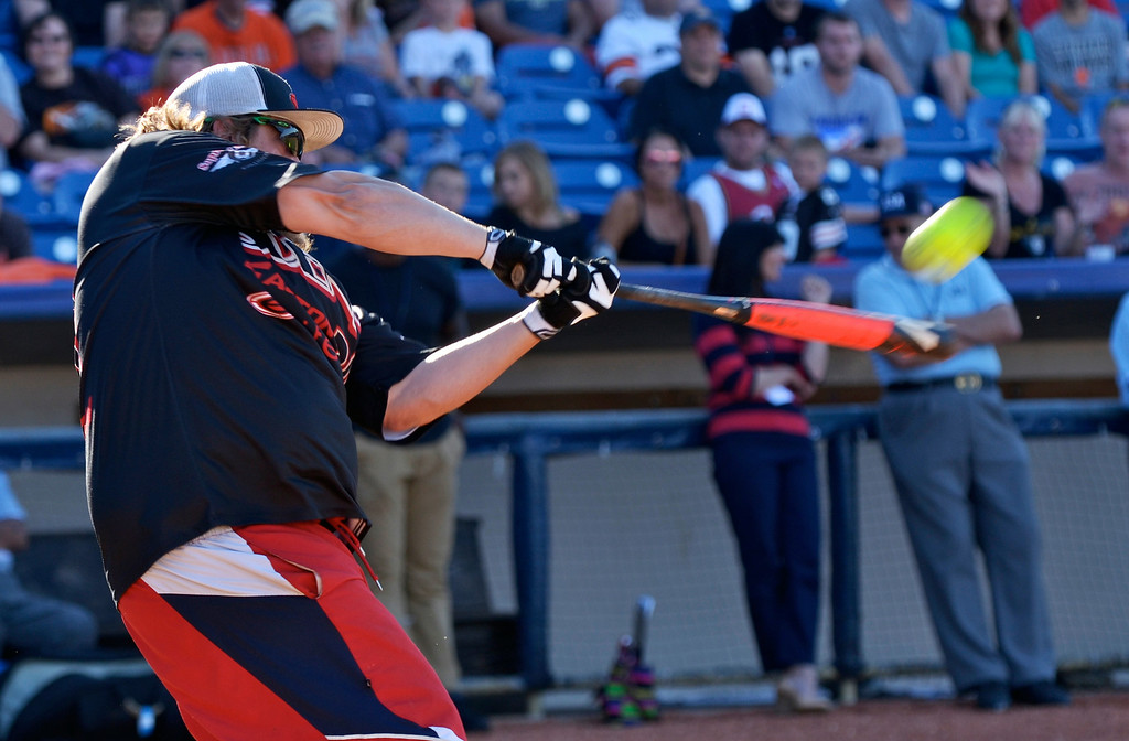 Description of . Jeff Forman/JForman@News-Herald.com Kyle Moyer hits it out of the park during the Joe Haden and Friends Softball Game home run derby July 17 at Classic Park.