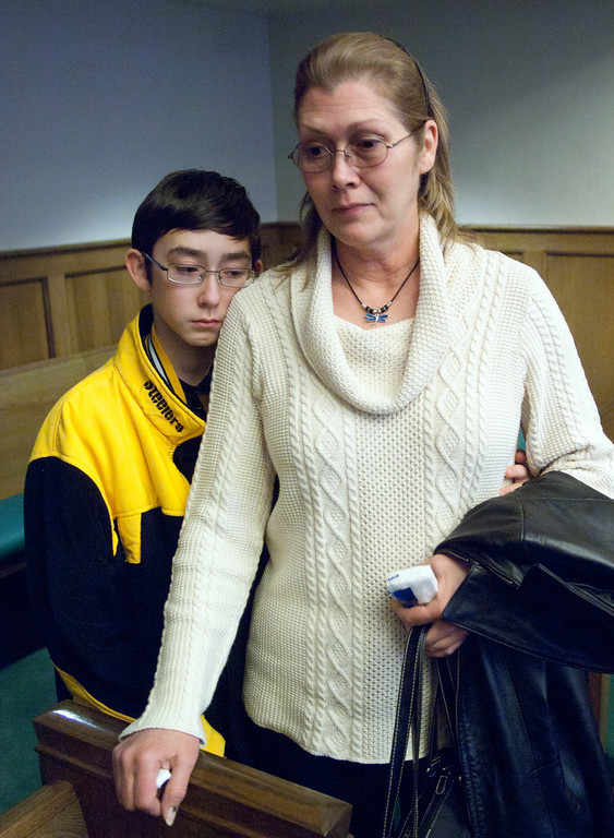 Description of . Duncan Scott/DScott@News-Herald.com Cathy Fayne, mother of murder victim William Andrew Fayne Putzbach, discusses the verdict on November 21, 2011 after a jury convicted Nathaniel Brown of aggravated murder. Her son Kristopher leans against his mother at left.