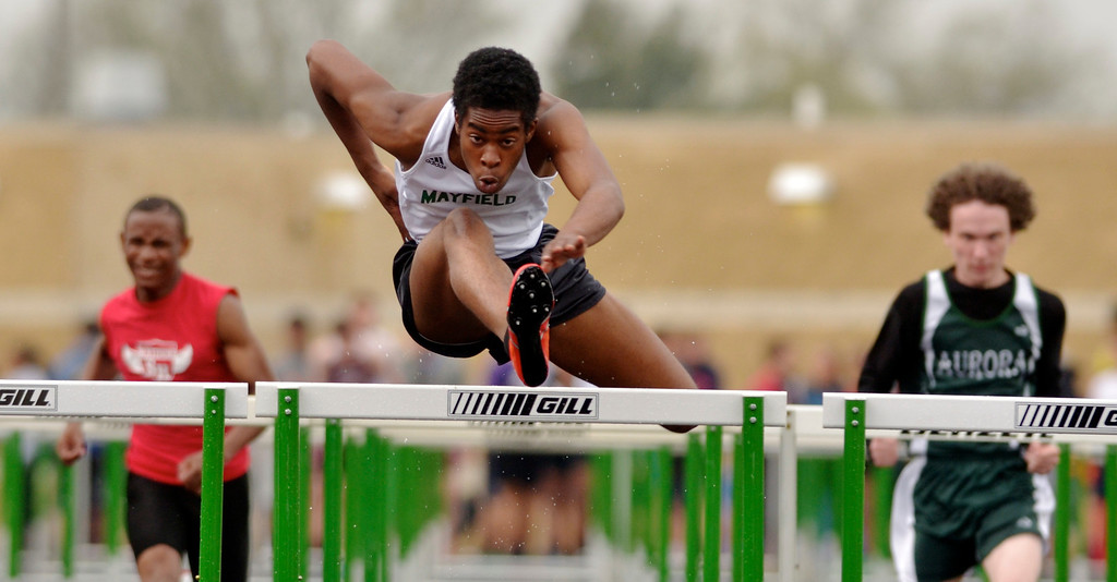 Description of . Jeff Forman/JForman@News-Herald.com Artrice Gordon, Mayfield, competes in a preliminary flight of the 100 meter hurdles during the Mayfield 2014 Track and Field Invitaional May 9 at Mayfield High School.