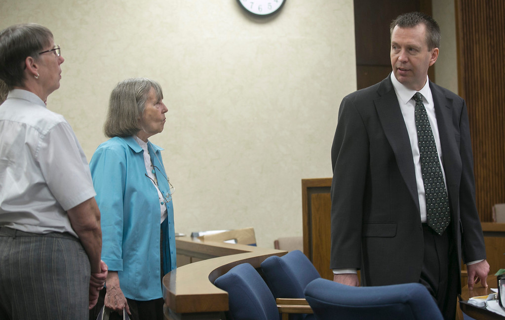 Description of . Michael Allen Blair/MBlair@News-Herald.com Kevin Knoefel talks with friends and family during a break portion of his murder conspiracy trial in Lake County Common Pleas Court on  June 4, 2014.