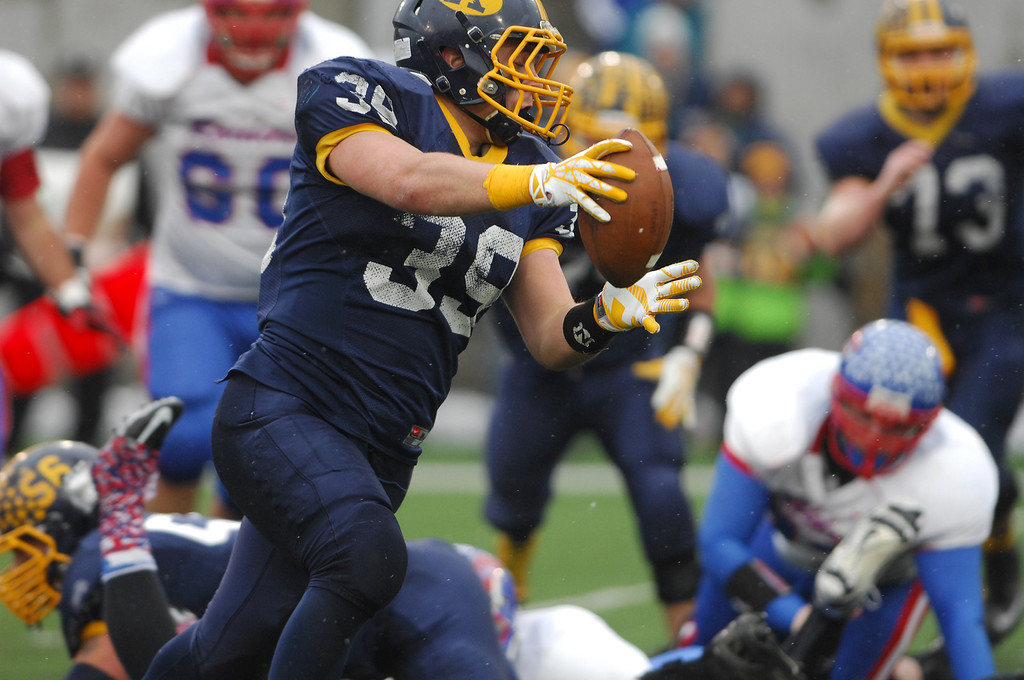 Description of . Michael Allen Blair/ MBlair@News-Herald.com Kirtland runningback Adam Hess runs in for a touchdown during the second quarter of Friday's Div VI state championship victory over Wayne Trace at Fawcett Stadium in Canton.