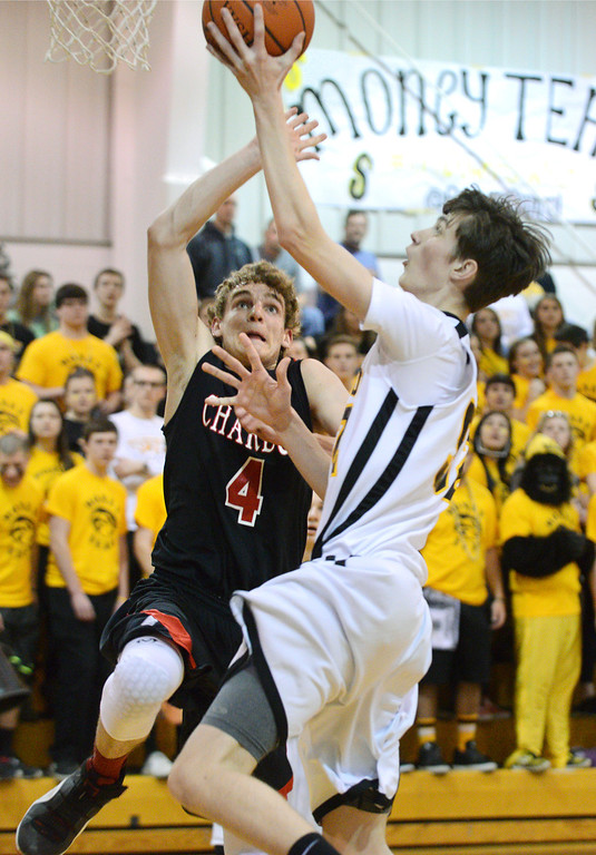 Description of . Duncan Scott/DScott@News-Herald.com Riverside's goes in for a layup in the fourth quarter defended by Chardon's Zach Weiland. Riverside won Friday's PAC matchup 49-43 at the Riverside Community Field House.