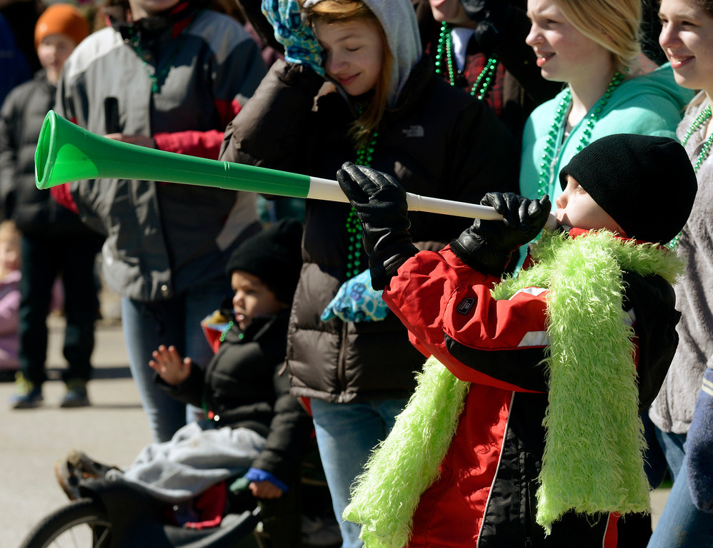 Description of . Maribeth Joeright/MJoeright@News-Herald.com<p> Timmy Hordinski, 9, of Mentor blows his horn as participants in the 147th annual St. Patrick's Day parade pass by, March 17, 2014.