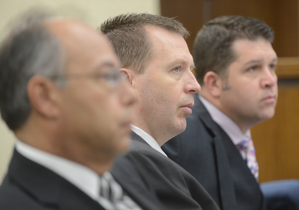 Description of . Duncan Scott/DScott@News-Herald.com Kevin Knoefel, center, listens to testimony with his defense team members, Dennis N. LoConti, left, and Gary Vick Jr. in Lake County Common Pleas Court on June 9, 2014, day six of Knoefel's trial on a charge of conspiracy to commit aggravated murder.