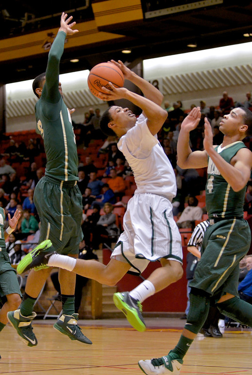 Description of . Jeff Forman/JForman@News-Herald.com Justin Robinson shoots in the first half of Lake Catholic's 68-52 Division II regional semifinal loss March 13 to St. Vincent St. Mary at the Canton Civic Center.