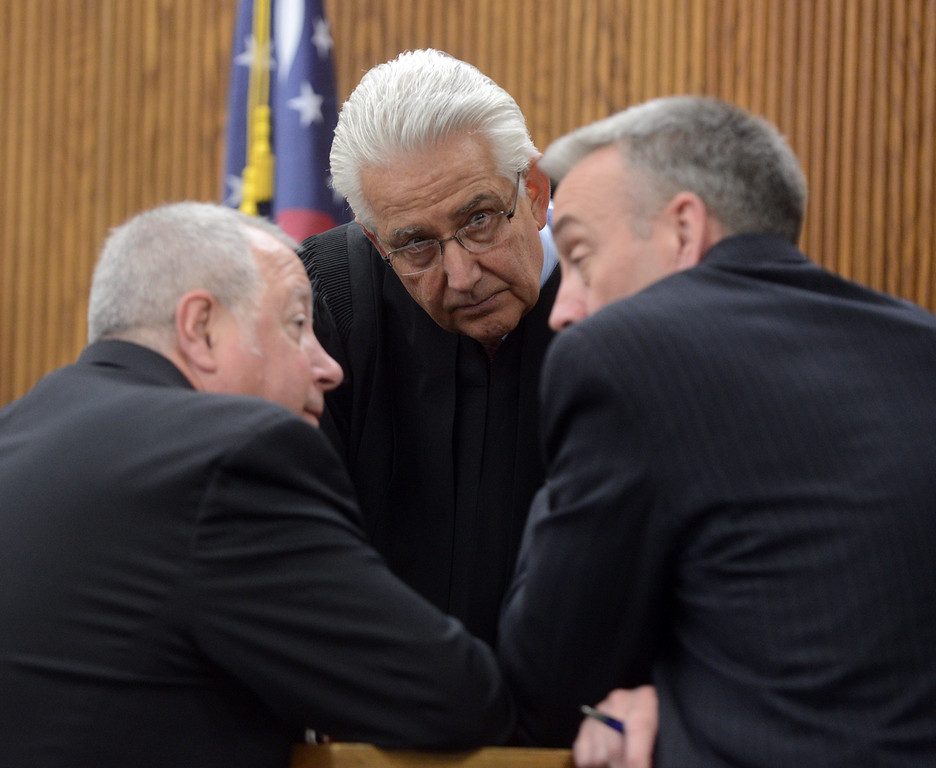 Description of . Duncan Scott/DScott@News-Herald.com Judge Joe Gibson, center, has a sidebar with defense attorney Michael J. Connick, left, and prosecutor John P. O'Donnell during testimony in Lake County Common Pleas Court on June 9, 2014, day six of Knoefel's trial on a charge of conspiracy to commit aggravated murder.