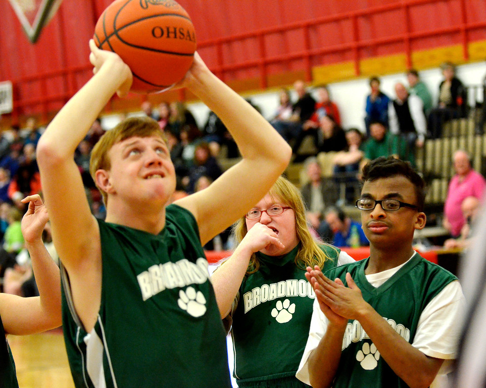 Description of . Jeff Forman/JForman@News-Herald.com  Jesse Davis takes a shot as teammates Casey Cronan and Patrick Coffee watch during Broadmoor School's game against area high school coaches March 24 at Mentor High School.