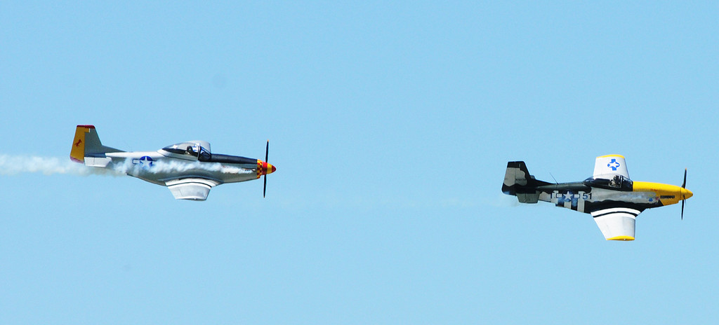 Description of . Jim Bobel/JBobel@MorningJournal.com Two Titan T-51 make a pass over the crowd at the Discover Aviation Air Show at the Lorain County Regional Airport. The plane is a three quater scale version of the World War II P-51 Mustang fighter plane. The planes are made in northeast Ohio.