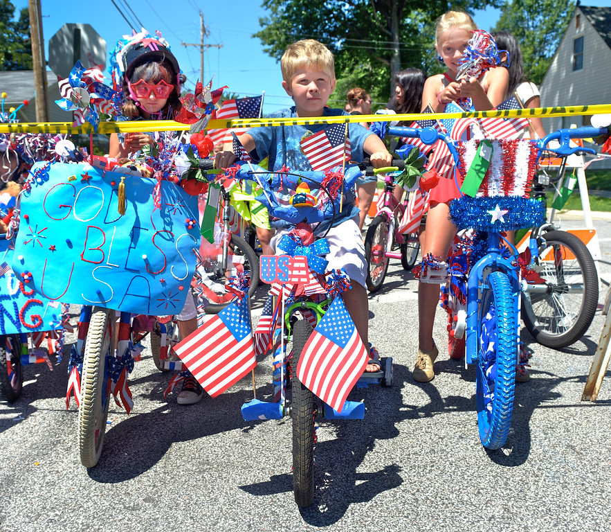 Description of . Jeff Forman/JForman@News-Herald.com Vanessa Horn, 7, left, Connor Coonce, 5, and Erica Kirby, 9, wait to ride their decorated bicycles in the Mentor Headlands July 4th Parade.